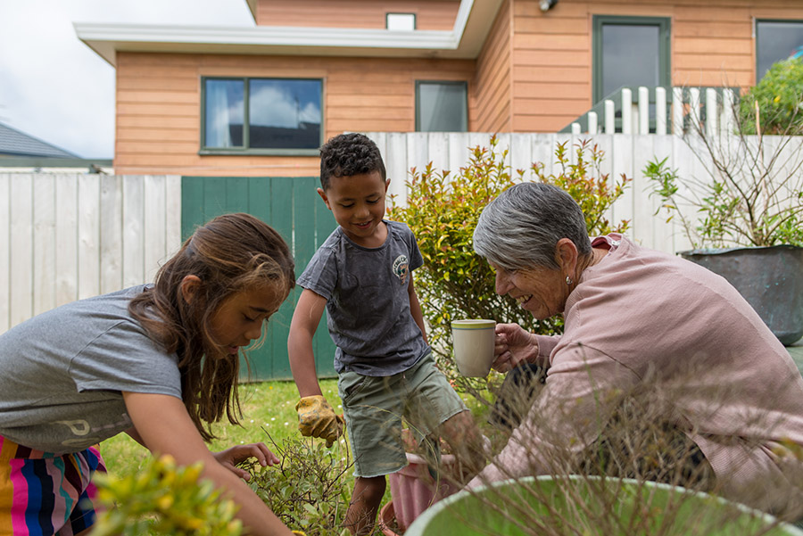 Grandmother gardening with grandchildren