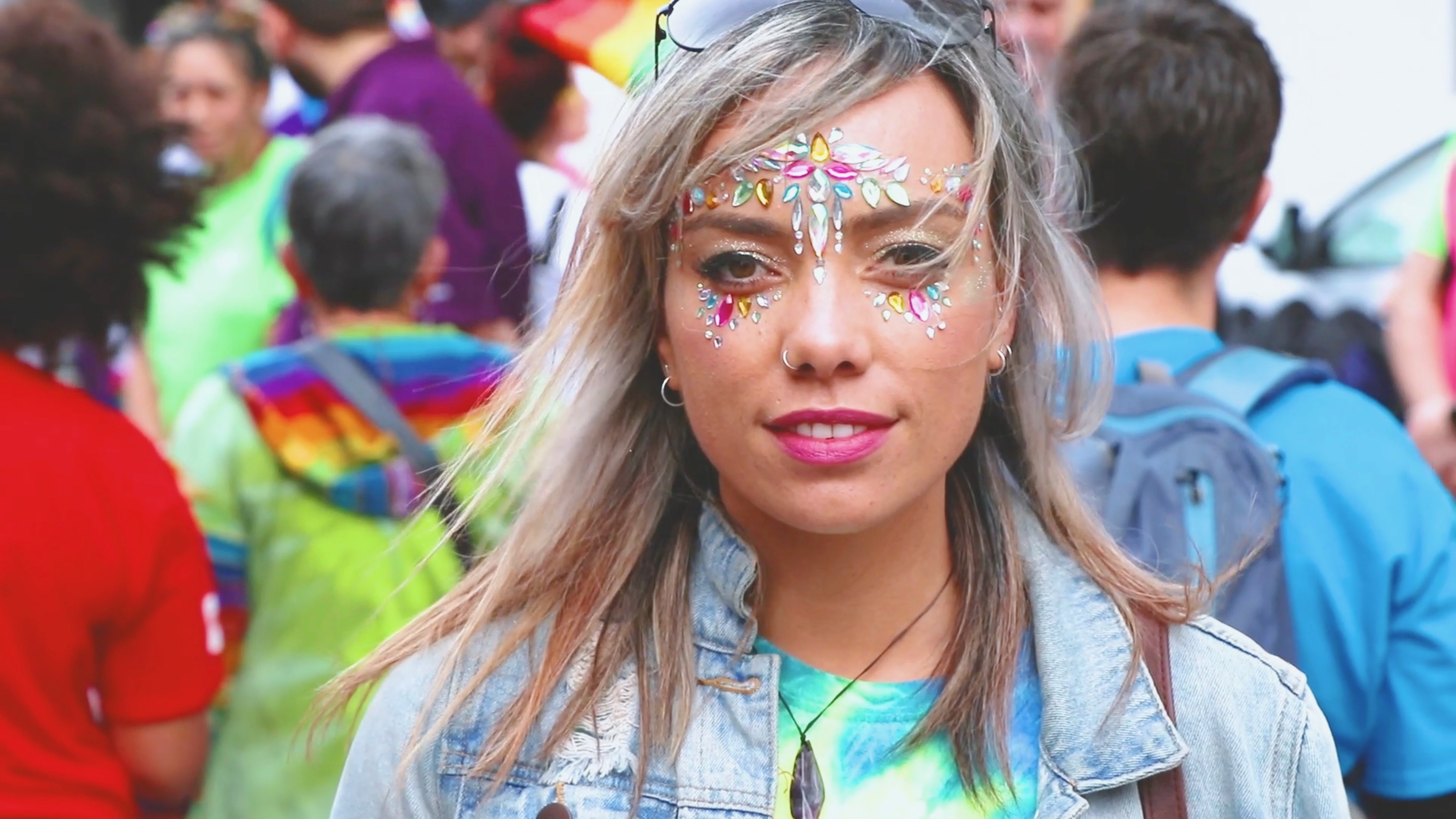 Woman wearing face paint at Pride Parade.