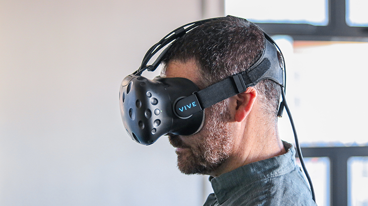 Man uses virtual reality headset