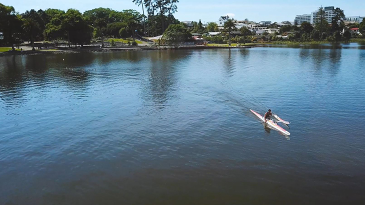 Peter Cowan paddling his outrigger canoe on Lake Rotoroa in Hamilton.