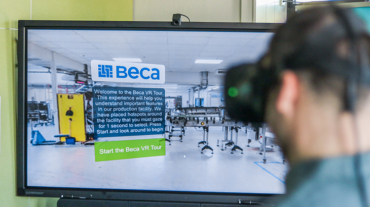 Man wears virtual reality headset demonstrating Beca's manufacturing module
