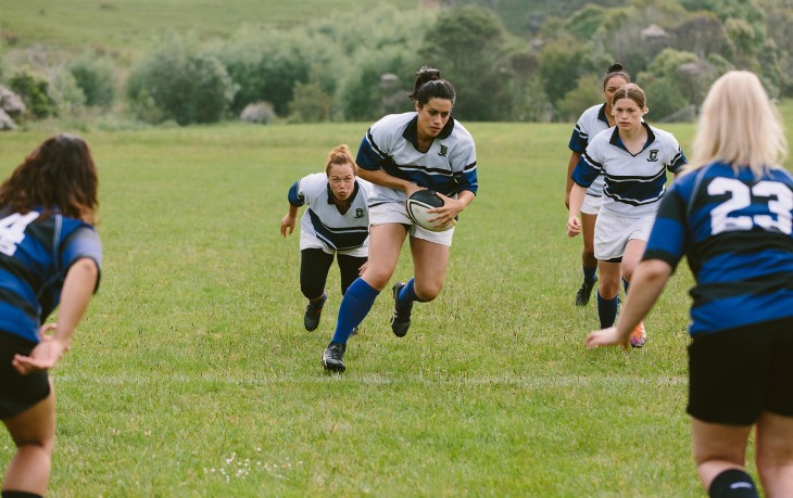 Woman's rugby team in play
